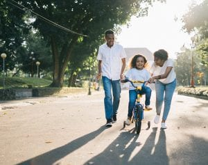 Family with Child Riding Bike